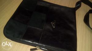 Muska kozna torbica Prada