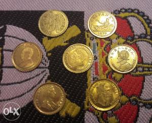 Sedam razlicitih zlatnih tokena
